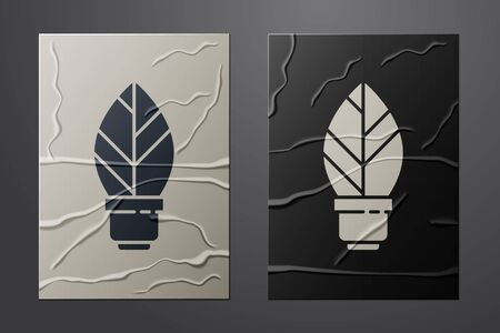 White Light bulb with leaf icon isolated on crumpled paper background. Eco energy concept. Alternative energy concept. Paper art style. Vector