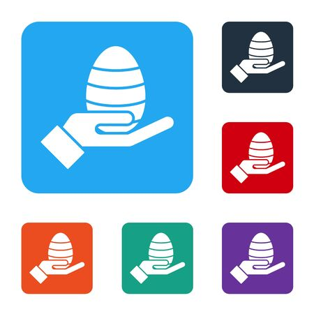 White Human hand and easter egg icon isolated on white background. Happy Easter. Set icons in color square buttons. Vector Illustration