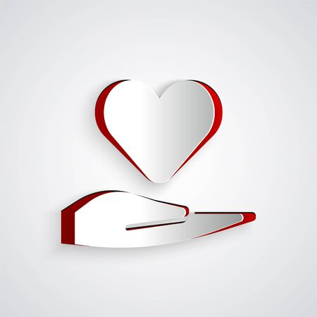 Paper cut Heart on hand icon isolated on grey background. Hand giving love symbol. Valentines day symbol. Paper art style. Vector