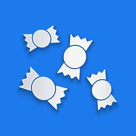 Paper cut Candy icon isolated on blue background. Paper art style. Vector Ilustração