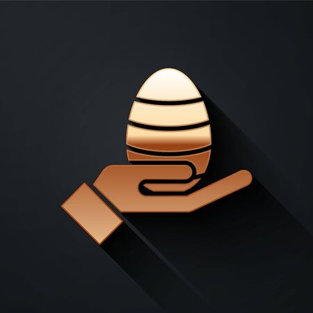 Gold Human hand and easter egg icon isolated on black background. Happy Easter. Long shadow style. Vector.