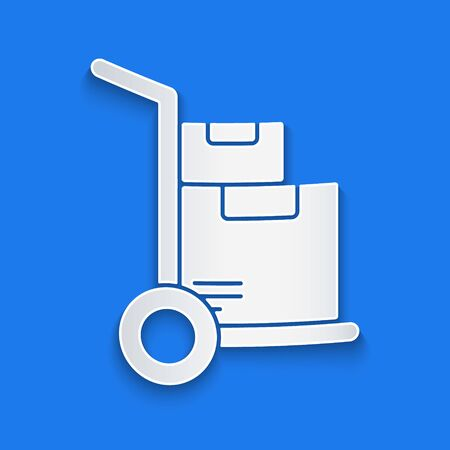 Paper cut Hand truck and boxes icon isolated on blue background. Dolly symbol. Paper art style. Vector. Illustration