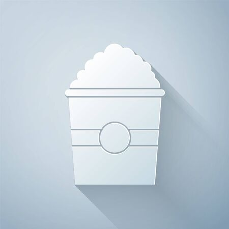 Paper cut Popcorn in cardboard box icon isolated on grey background. Popcorn bucket box. Paper art style. Vector Illustration
