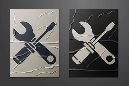 White Screwdriver and wrench spanner tools icon isolated on crumpled paper background. Service tool symbol. Paper art style. Vector Illustration.