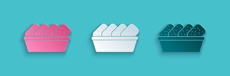 Paper cut Chicken nuggets in box icon isolated on blue background. Paper art style. Vector Illustration.