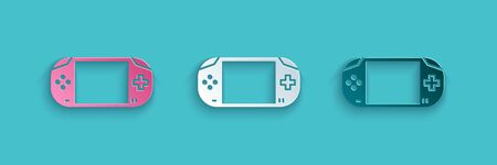 Paper cut Portable video game console icon isolated on blue background. Gamepad sign. Gaming concept. Paper art style. Vector Illustration.