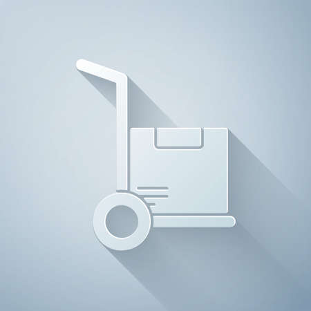 Paper cut Hand truck and boxes icon isolated on grey background. Dolly symbol. Paper art style. Vector Illustration.
