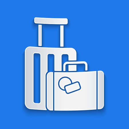 Paper cut Suitcase for travel icon isolated on blue background. Traveling baggage sign. Travel luggage icon. Paper art style. Vector Illustration.