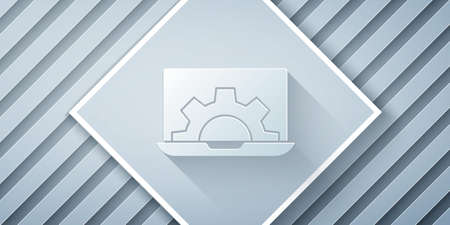 Paper cut Laptop and gear icon isolated on grey background. Adjusting app, setting options, maintenance, repair, fixing. Paper art style. Vector Illustration. Archivio Fotografico - 150644846