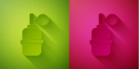 Paper cut Hand grenade icon isolated on green and pink background. Bomb explosion. Paper art style. Vector. Ilustrace
