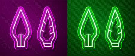 Glowing neon line Stone age arrow head icon isolated on purple and green background. Medieval weapon. Vector.