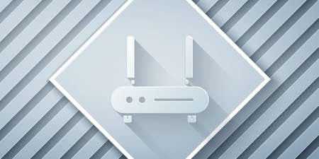 Paper cut Router and wifi signal icon isolated on grey background. Wireless internet modem router. Computer technology internet. Paper art style. Vector Illustration.