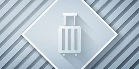 Paper cut Suitcase for travel icon isolated on grey background. Traveling baggage sign. Travel luggage icon. Paper art style. Vector Illustration.