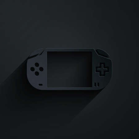 Paper cut Portable video game console icon isolated on black background. Gamepad sign. Gaming concept. Paper art style. Vector Illustration