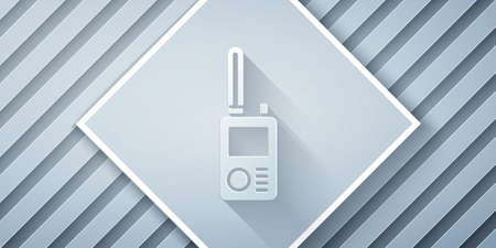 Paper cut Walkie talkie icon isolated on grey background. Portable radio transmitter icon. Radio transceiver sign. Paper art style. Vector 向量圖像