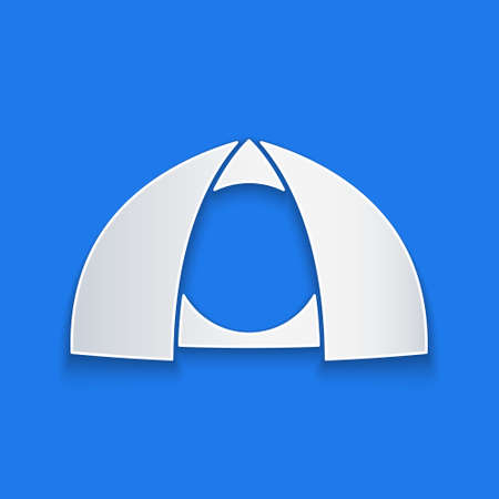 Paper cut Tourist tent icon isolated on blue background. Camping symbol. Paper art style. Vector