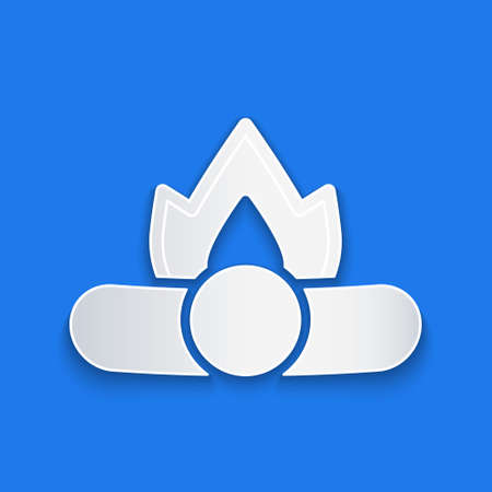 Paper cut Campfire icon isolated on blue background. Burning bonfire with wood. Paper art style. Vector Illustration