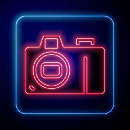 Glowing neon Photo camera icon isolated on blue background. Foto camera icon. Vector