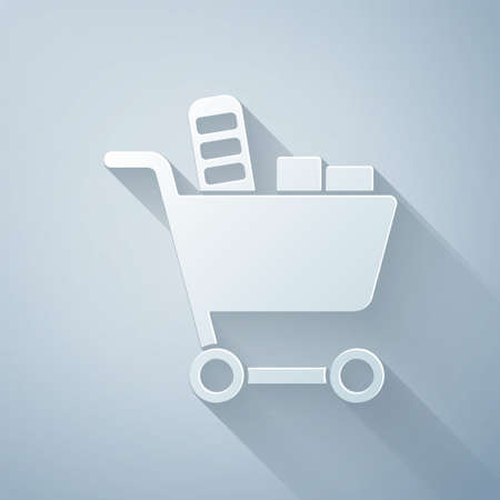 Paper cut Shopping cart and food icon isolated on grey background. Food store, supermarket. Paper art style. Vector