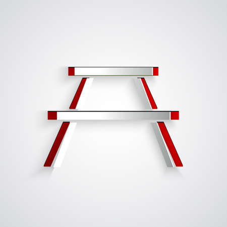 Paper cut Picnic table with benches on either side of the table icon isolated on grey background. Paper art style. Vector