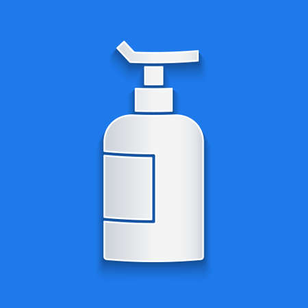Paper cut Cream or lotion cosmetic tube icon isolated on blue background. Body care products for woman. Paper art style. Vector