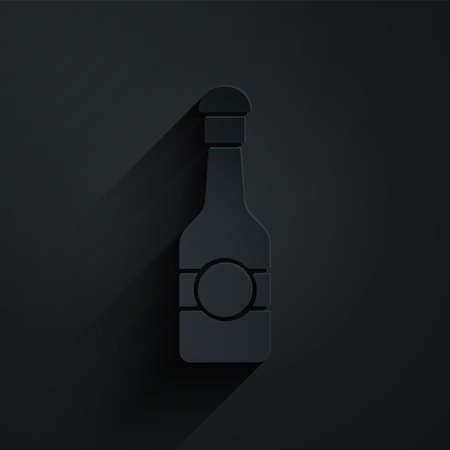 Paper cut Champagne bottle icon isolated on black background. Merry Christmas and Happy New Year. Paper art style. Vector