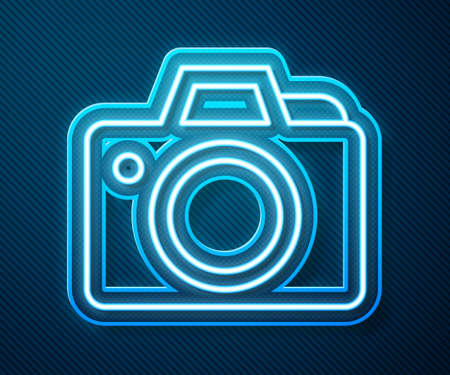 Glowing neon line Photo camera icon isolated on blue background. Foto camera icon. Vector