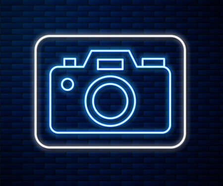 Glowing neon line Photo camera icon isolated on brick wall background. Foto camera icon. Vector