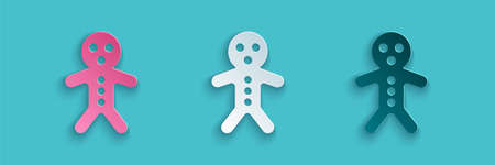 Paper cut Holiday gingerbread man cookie icon isolated on blue background. Cookie in shape of man with icing. Paper art style. Vector