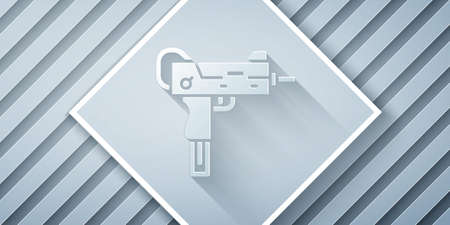 Paper cut   submachine gun icon isolated on grey background. Automatic weapon. Paper art style. Vector Ilustração