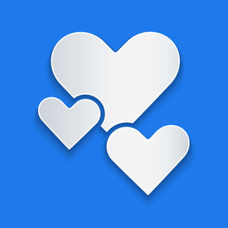 Paper cut Heart icon isolated on blue background. Romantic symbol linked, join, passion and wedding. Valentine day symbol. Paper art style. Vector