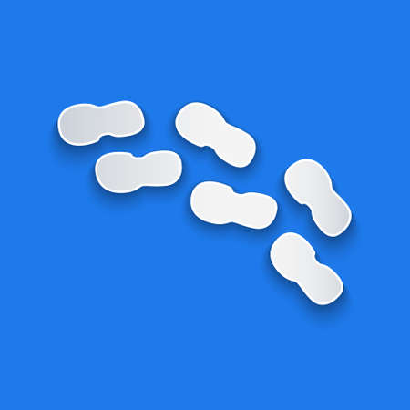 Paper cut Human footprints shoes icon isolated on blue background. Shoes sole. Paper art style. Vector
