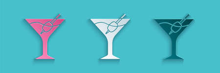 Paper cut Martini glass icon isolated on blue background. Cocktail icon. Wine glass icon. Paper art style. Vector 向量圖像