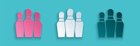 Paper cut Bowling pin icon isolated on blue background. Paper art style. Vector
