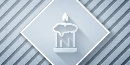 Paper cut Burning candle in candlestick icon isolated on grey background. Old fashioned lit candle. Cylindrical candle stick with burning flame. Paper art style. Vector