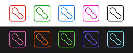 Set line Human footprints shoes icon isolated on black and white background. Shoes sole. Vector