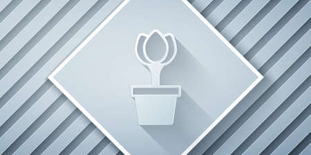 Paper cut Flower tulip in pot icon isolated on grey background. Plant growing in a pot. Potted plant sign. Paper art style. Vector