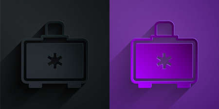 Paper cut First aid kit icon isolated on black on purple background. Medical box with cross. Medical equipment for emergency. Healthcare concept. Paper art style. Vector