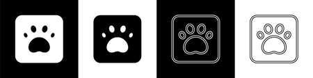 Set Paw print icon isolated on black and white background. Dog or cat paw print. Animal track. Vector