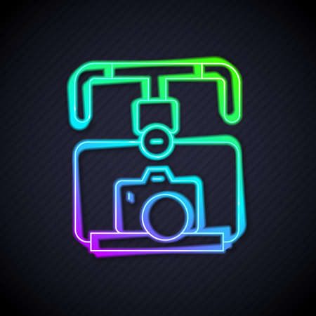 Glowing neon line Gimbal stabilizer with DSLR camera icon isolated on black background. Vector Çizim