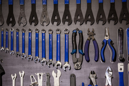 Tools hanging on wall in workshop room. 写真素材