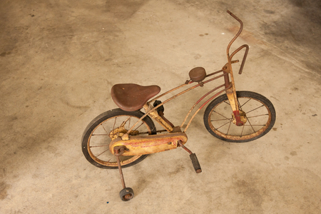 Old vintage bicycle for kid with rust on.