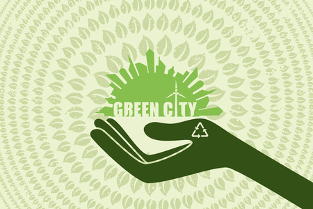 city live: Save environment and green power concept. Hand holding the graphic of city with text inside and green leaf flow around.