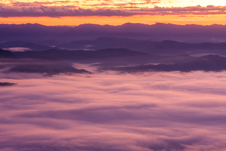 Morning scene of fog on high hill landscape along the valley and sunrise atmosphere from mountain peak.