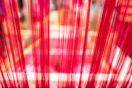 Abstract background of thread on bobbin prepared for weaving and making clothes.