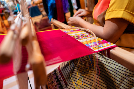 Process of making handmade silk fabric with traditional graphic style.