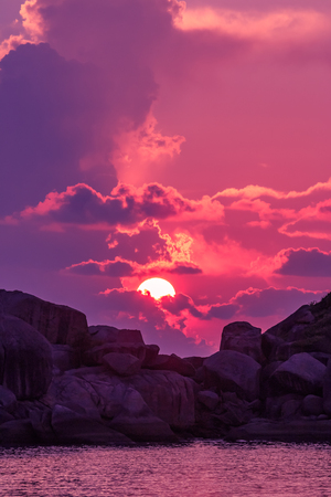 Landscape of sunset with dramatic sky on background with rock island and sea. Stock fotó - 126325912