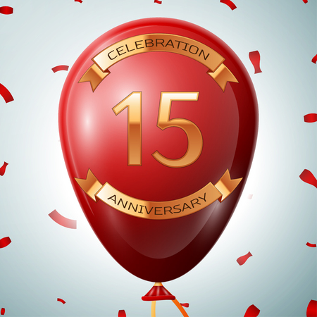 fifteen: Red balloon with golden inscription fifteen years anniversary celebration and golden ribbons on grey background and confetti.