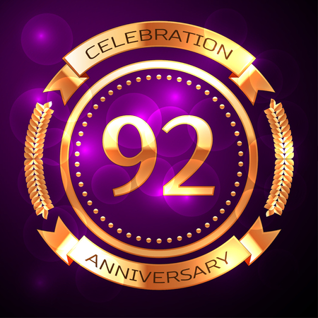 92: Ninety two years anniversary celebration with golden ring and ribbon on purple background.