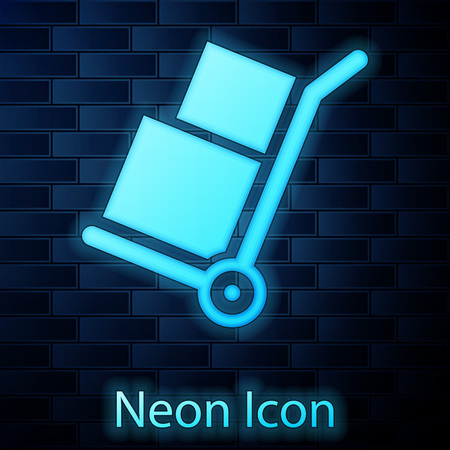 Glowing neon Hand truck and boxes icon isolated on brick wall background. Dolly symbol. Vector Illustration
